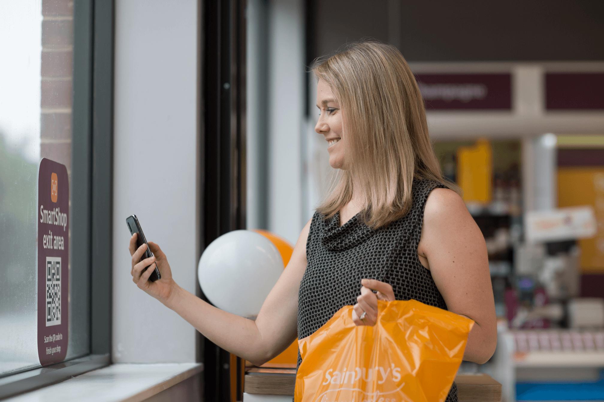 Sainsburys-SmartShop-scan-pay-&-go-trial--customer-scanning-Exit-QR-code-to-finish-shop